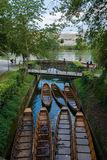 Boats Canoes on Small Canal at Danube River in Ulm, Germany Royalty Free Stock Images