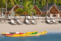 Boats and canoes on a tropical beach Stock Image