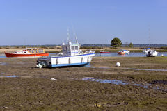 Boats at  Cap-Ferret in France. Boats at low tide at Cap-Ferret, ostreicole commune located on shore of Arcachon Bay, in the Gironde department in southwestern Stock Images