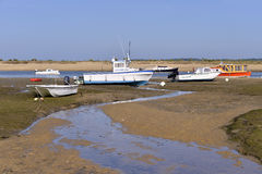 Boats at  Cap-Ferret in France. Boats at low tide at Cap-Ferret, ostreicole commune located on shore of Arcachon Bay, in the Gironde department in southwestern Stock Photos