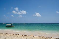 Boats on caribbean beach Stock Image