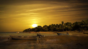 Boats on caribbean sea. Golden sunset over caribbean sea and beach Royalty Free Stock Image