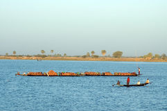 Boats carrying goods across river in Africa Stock Photo