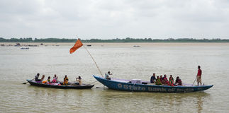 Boats carrying tourists on Ganges river in Varanasi, India Stock Images