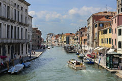 Boats on a channel in Venice Stock Photos