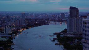 Boats in Chao Phraya River at dusk in Bangkok City in transportation concept, Thailand.  stock video