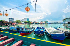 Boats at the Chew Jetty which is one of the UNESCO World Heritage Site in Penang. Royalty Free Stock Photo