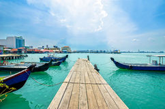 Boats at the Chew Jetty which is one of the UNESCO World Heritage Site in Penang. Stock Photo