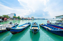 Boats at the Chew Jetty which is one of the UNESCO World Heritage Site in Penang. Penang,Malaysia - July 17,2015 : Boats at the Chew Jetty which is one of the Royalty Free Stock Photography