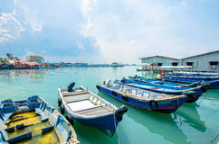 Boats at the Chew Jetty which is one of the UNESCO World Heritage Site in Penang. Penang,Malaysia - July 17,2015 : Boats at the Chew Jetty which is one of the Royalty Free Stock Photos