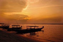 Silhouette of boats on a lake during sunset Stock Images