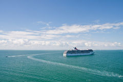 Boats Circling Cruise Ship on Blue Sea Stock Photos