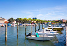 Boats in the city center of Grado, Italy stock images
