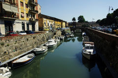 Boats in city channel in Livorno, Italy Royalty Free Stock Photo