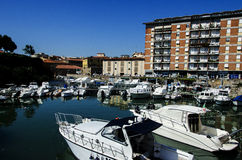 Boats in city channel in Livorno, Italy Royalty Free Stock Image