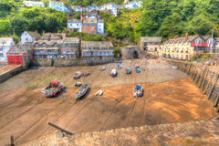 Boats in Clovelly harbour Devon England UK at low tide in HDR Royalty Free Stock Images