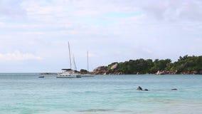 Boats at the coast of Anse Lazio, Praslin island, Seychelles. Boats waiting at the coast of Anse Lazio, Praslin island, Seychelles stock video