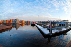 Boats and colorful buildings at Reitdiephaven, Groningen Royalty Free Stock Photography
