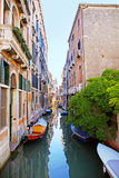 Boats and colorful houses in Venice Royalty Free Stock Image