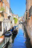 Boats and colorful houses in Venice Stock Image