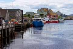 Boats, colourful wooden buildings, harbour, Peggy's Cove, Nova Scotia Stock Image