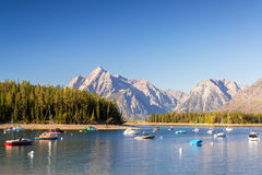 Boats in Colter Bay. With the Teton Mountain Range in the background in Ground Teton National Park Royalty Free Stock Photos