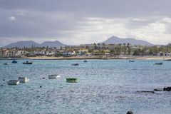 Boats in Corralejo with town and mountains in the background Royalty Free Stock Images