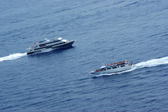 Boats on course of collision w Stock Images
