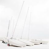 Boats covered by snow in a white beach in winter Stock Image