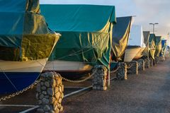 Boats covered with tarpaulin in winter storage. In Kristiansand, Norway Royalty Free Stock Photo