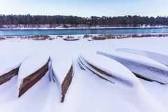 Boats covered in thick snow at winter royalty free stock image
