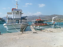 Boats on Cretan sea. Beautiful boats which were docked on a little port of the Cretan sea Stock Photography