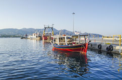 Boats in Crete Island. Boats in agios nikolaos port, Crete Island, Greece, with blue background Royalty Free Stock Images