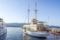 Boats in Crete Island. Boat in agios nikolaos port, Crete Island, Greece, with blue background Royalty Free Stock Image