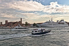 Boats and Cruise Ship Star Pride in Venice, Italy Stock Images