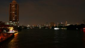 Boats cruising on the Chao Praya River at dusk. stock video footage