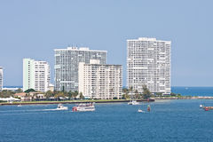 Boats Cruising Past Coastal Condos Royalty Free Stock Photo