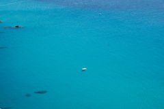 Boats on the crystal clear sea near the town of Tropea region Calabria Royalty Free Stock Photo