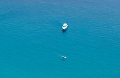 Boats on the crystal clear sea near the town of Tropea region Calabria Royalty Free Stock Image