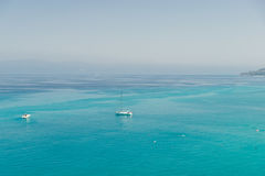 Boats on the crystal clear sea near the town of Tropea region Calabria Stock Photography