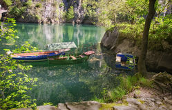Boats on a dam in spring, Canyon Matka. Royalty Free Stock Photography