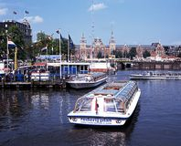Boats on Damrak, Amsterdam. Stock Photo