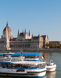 Boats on the Danube. In Budapest, with the Hungarian Parliament building in the background stock photo