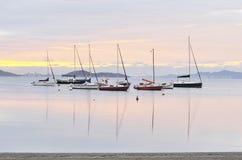 Boats at Daybreak. Sailing boats and islands at daybreak stock photo