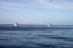 Boats Deep Sea Fishing. Two boats deep sea fishing Stock Photography