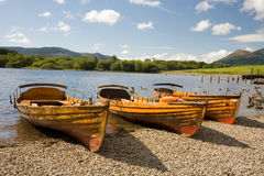 Boats on Derwentwater. Rowing boats on Derwentwater in Cumbria in the English Lake District stock photography