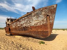 Boats in desert - Aral sea or Aral lake - Uzbekistan - asia. Boats in desert around Moynaq, Muynak or Moynoq - Aral sea or Aral lake - Uzbekistan - asia Royalty Free Stock Photo