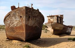 Boats in desert - Aral sea. Boats in desert around Moynaq, Muynak or Moynoq - Aral sea or Aral lake - Uzbekistan - asia Stock Image