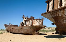 Boats in desert - Aral sea. Boats in desert around Moynaq, Muynak or Moynoq - Aral sea or Aral lake - Uzbekistan - asia Stock Photos