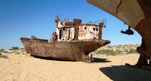 Boats in desert - Aral sea. Boats in desert around Moynaq, Muynak or Moynoq - Aral sea or Aral lake - Uzbekistan - asia Royalty Free Stock Image